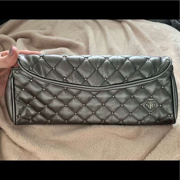 Tiffany & Co. Handbags - Auth. Tiffany studded Sadie clutch